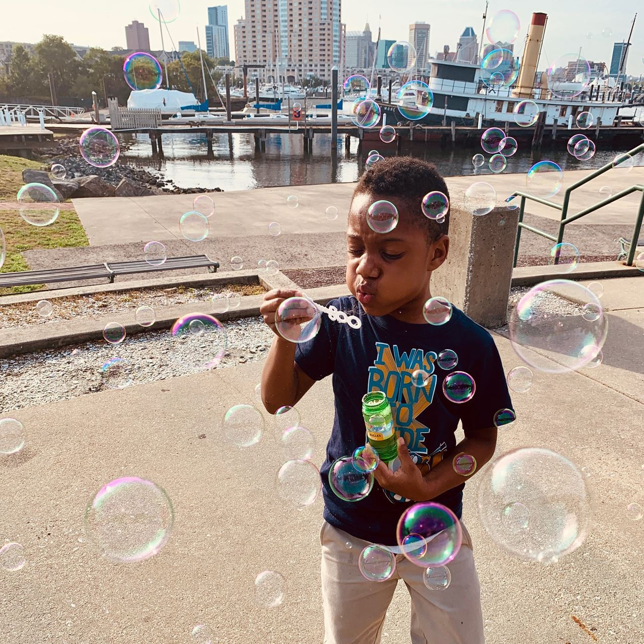 Baybrook OST student learns about wind by blowing bubbles