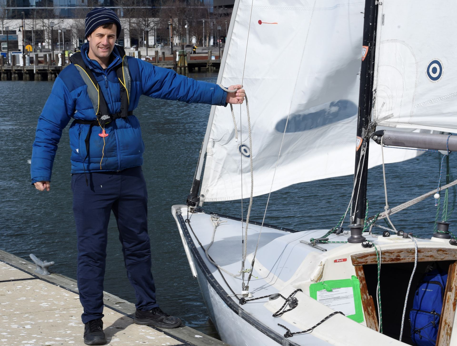 Instructor Graham waiting for you to Step Aboard our Sonar sailboat
