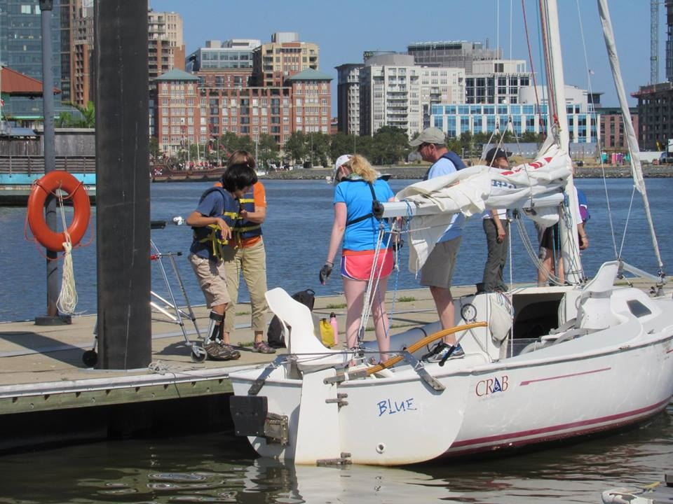 A Freedom Independence 20 Sailboat is readied for sailors to embark on a sunny harbor sail!