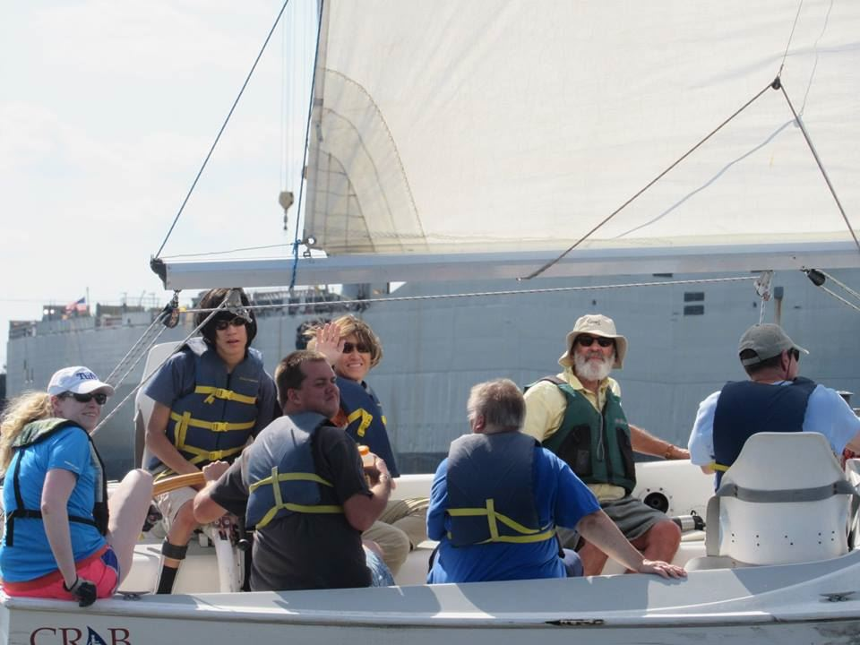 Chris steers with Norlan in the tactician's seat on a Freedom Independence 20 sailboat with friends and family